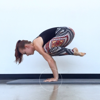 This image shows crow pose with hasta bandha engaged. Notice how all of my knuckles are pressing into the mat. Using hasta bandha will prevent wrist pain and lead to stronger arm balances and inversions.