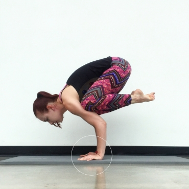This picture shows crow pose without hasta bandha engaged. Noticed how my knuckles are lifting off of the ground. Over time, practicing yoga like this will lead to chronic wrist pain.